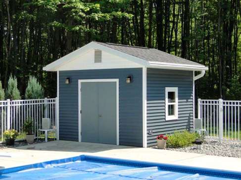 Tops can construct and coordinate the roof, siding and windows on any garage, shed or other storage building just like this pool house.