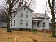 Turn of the century farm house located in Millcreek, PA showing old roof needing repair or replacement.