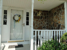 For this  S.W. Millcreek, PA  Colonial home, Plygem stone work and railings really added character and class to the front porch entrance.