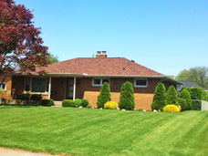 In N.W. Millcreek, PA, Tops Roofing and Remodeling utilized New Landmark Pro Roofing Shingles to really improve the beauty of this classic brick ranch style home.